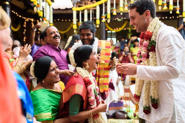 In the picture, Sharma sat on her mother Raji's lap for the ceremony. Traditionally, women sit on their father's laps for the occasion.