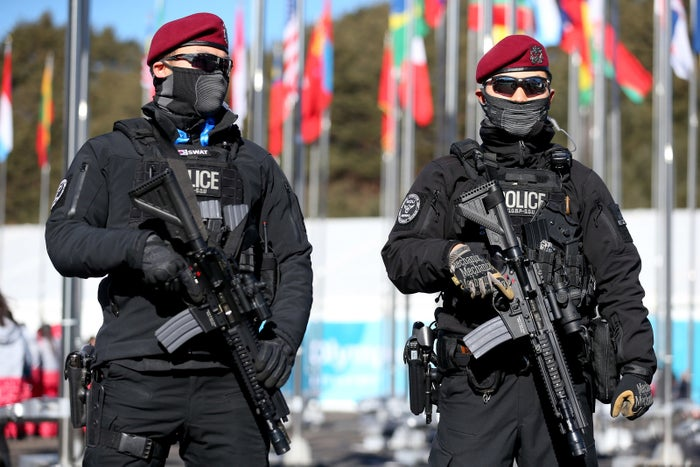 Riot police at the Olympic Village.