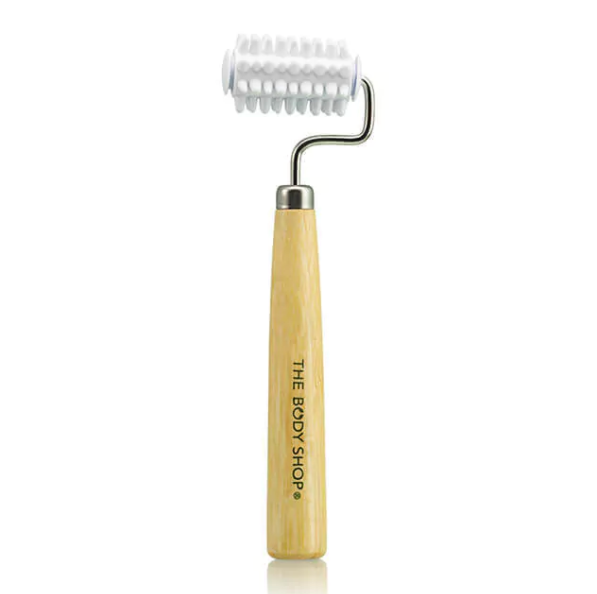 """Promising review: """"This helps to massage your face. I'd definitely recommend using it after a facial oil to help push that further into your skin. The roller itself isn't plastic, it's rubber, which came as a surprise! It makes this even better! It doesn't hurt the skin. If you pick pimples, this is also a great alternative or distraction — just roll this across the face instead! You'll get your massage and facial blood circulation."""" —ShreyaaGet it from The Body Shop for $6.40 (originally $8)."""