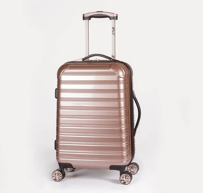f4d88a9c45e2bc A stylish rose gold hard-side bag that'll last through all your trips.