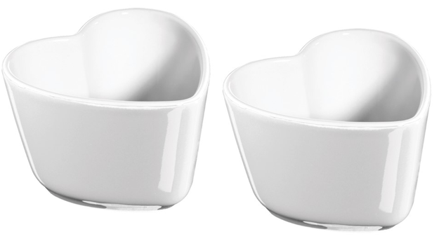 A pair of ceramic ramekins that are oven and broiler safe up to 572°F.
