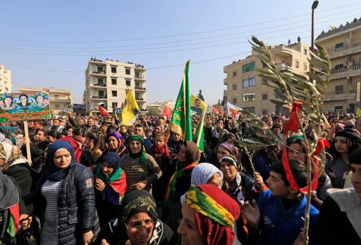 Syrian Kurds, Arabs, and Syriacs bussed in from across northern Syria demonstrate against the Turkish offensive, in the centre of the Kurdish city of Afrin on Feb. 6.