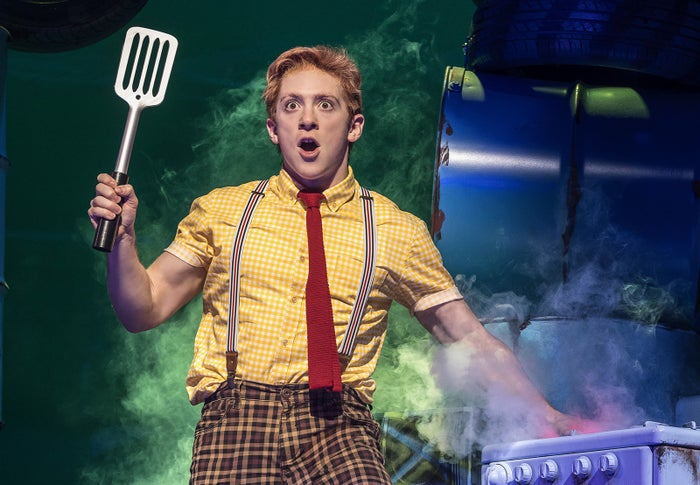 """The moment Ethan Slater appears onstage —instantly showcasing his fine-tuned command of SpongeBob's vocals and mannerisms —you'll see that he was born to play this part. And when he belts his soaring anthem, """"(Just a) Simple Sponge,"""" you'll realize that he's a bonafide star. Slater displays a commitment to the character of an anthropomorphic sea sponge that is downright heroic. He's giving a comic performance that's both goofy and completely sincere —it would be tempting to allow a hint of irony here, but he eschews that —and it's that earnestness that makes his SpongeBob so relentlessly charming. (His arms don't hurt either. Who knew SpongeBob was so built?)"""