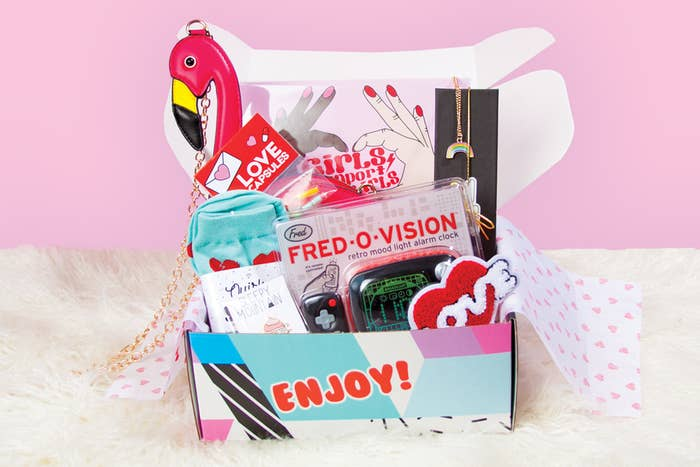 """What it is: A box of bright, playful goods guaranteed to instantly put a smile on anyone's face (even those """"Yeah...I don't celebrate Valentine's Day""""-type people). Each box includes an enamel pin from a featured artist as well as a fun pair of socks. The Quirky Post includes three items and the Quirky Crate includes six to nine. Promising review: """"Quirky Crate is always a fun surprise to open each month! It is a box full of themed items which change per month, that are pretty random. You could get a journal one month or a crazy flamingo purse the next. I have always been able to find at least half of the things in the crate something that I enjoy. I would highly recommend this to anyone that likes cute and random things!"""" —FayPrice: $12.95/month for the Quirky Post or $34.99/month for the Quirky Crate."""