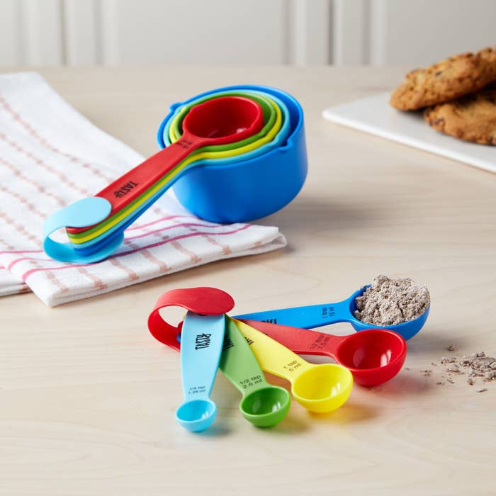 The cups and the spoons both come in a set of five increments.  Get it from the Tasty collection at Walmart for $5.97.