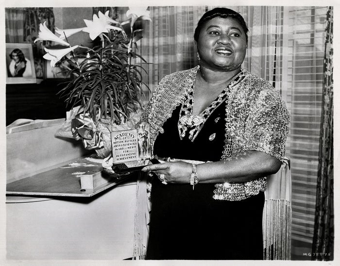 Actor Hattie McDaniel shows off her Academy Award from the film Gone With the Wind in 1940.