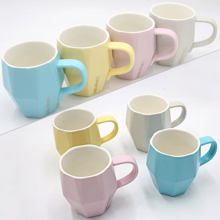 """Promising review: """"These are a perfect size for a cup of coffee and so attractive. I use a Keurig and select the mug size and these mugs leave a perfect amount of room for sugar and cream. I can walk to my table or my office without the danger of spilling over the top! The finish is matte and the colors are perfect."""" —DleePrice: $19.99"""