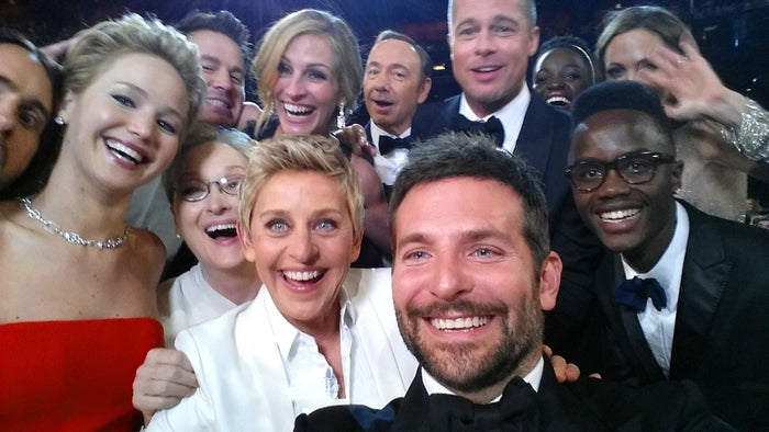 Host Ellen DeGeneres poses for a selfie taken by Bradley Cooper with (clockwise from left to right) Jared Leto, Jennifer Lawrence, Channing Tatum, Meryl Streep, Julia Roberts, Kevin Spacey, Brad Pitt, Lupita Nyong'o, Angelina Jolie, Peter Nyong'o Jr., and Bradley Cooper during the 86th Academy Awards on March 2, 2014.