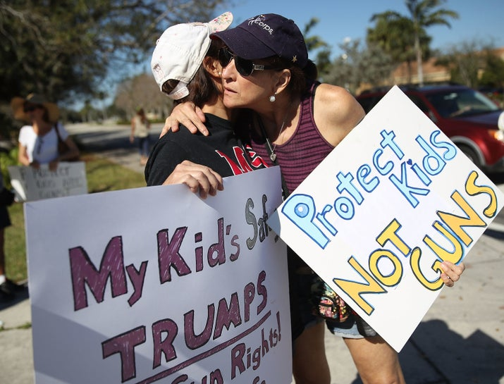Debby Stout (left), whose daughter survived the shooting at Marjory Stoneman Douglas High School, is hugged by Lori Feldman during a protest against guns.