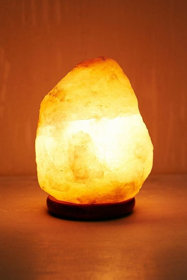 While blue light is terrible for sleep, red light is actually great. The soft warm glow of a salt lamp is bright enough to see the page of your book, but dark enough that it won't disturb you if you fall asleep with it on.Get it from Urban Outfitters for $34 (available in two colors).