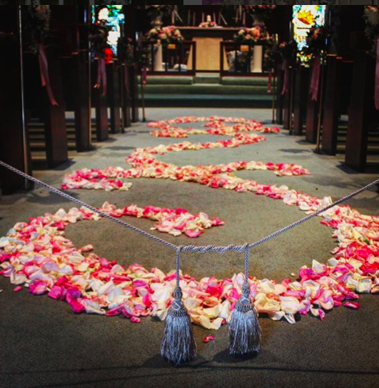 In place of an aisle runner, use rose petals.