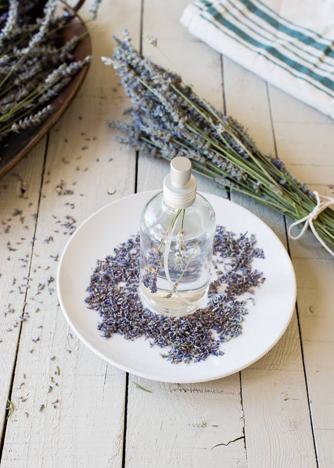 The smell of lavender actually lowers your heart rate and blood pressure, and increases the brain activity associated with sleep.To make a simple lavender spray, combine two cups of water, two cups of vodka, and 15-20 drops of lavender oil in a spray bottle.