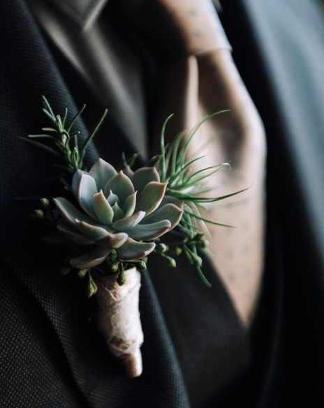 Stray away from tradition by giving your groomsmen succulent boutineers.