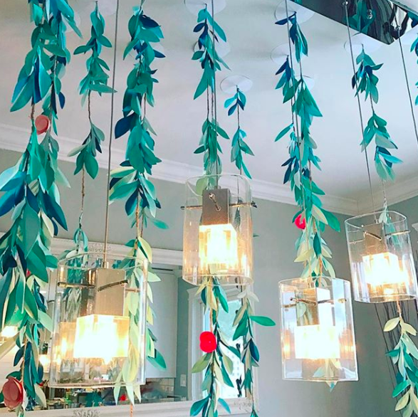 Get crafty by DIY-ing some vibrant paper pom pom vines for decor.