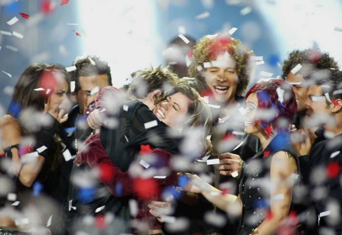 Winner Kelly Clarkson embraces fellow contestants during the American Idol Season 1 finale on Sept. 4, 2002.