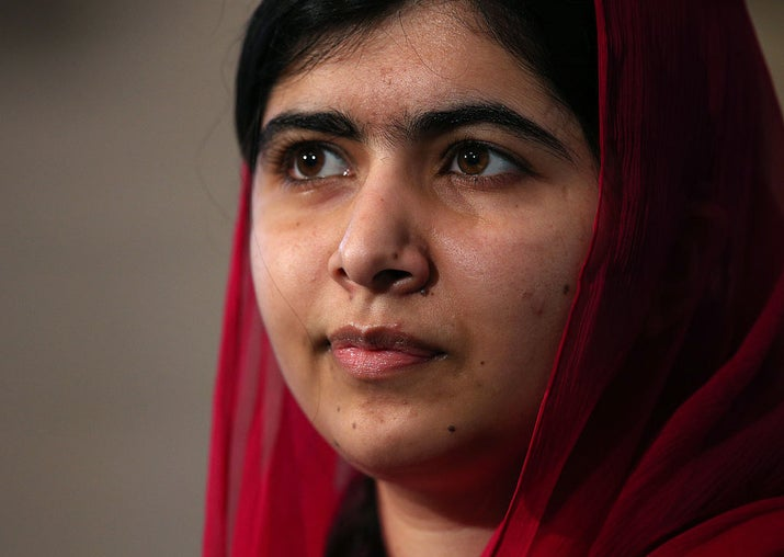 """When Yousafzai was just 11, the Taliban began attacking her school in Pakistan. This inspired her to make a speech, """"How dare the Taliban take away my basic right to education?"""" which led to a regular anonymous column in the BBC. Despite death threats, she continued to attend school — until she was shot by the Taliban on the way home from school in 2012. After recovering, she only increased her advocacy for human rights and education. She founded the non-profit Malala Fund, which works to secure girls' right to a minimum of 12 years of quality education, wrote a book, I Am Malala, and became the youngest Nobel laureate at 17."""