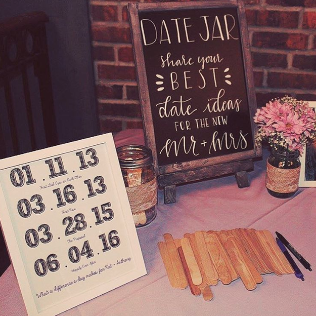 "Have your guests participate in small activities, like writing a ""date night idea"" on a popsicle stick and putting it in a jar."