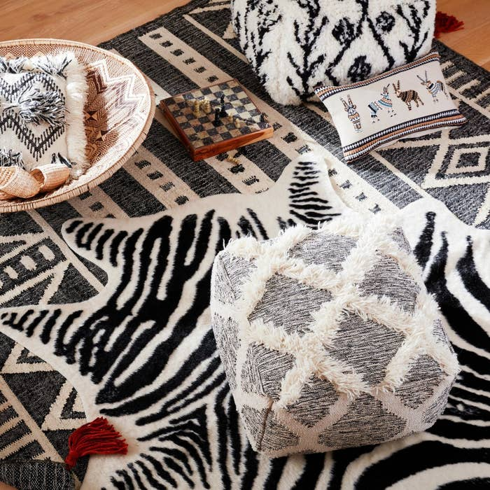 Also, it just makes you look like you're been places. The key to making this work is finding some common colors between each piece.Get these rugs from World Market: faux zebra hide for $149.99 and flatweave jute rug for $269.99+ (two sizes)Check out affordable rug offerings (the better for layering, my pretty) from Amazon, Wayfair, Overstock, Walmart, and World Market.