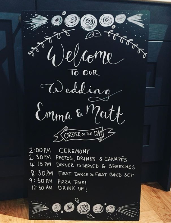 Or don't spend money on wedding programs at all and use a blackboard to inform your guests of the itinerary.