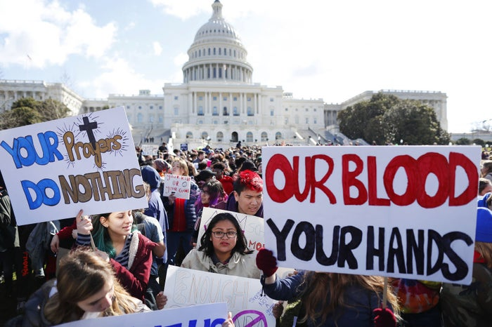 Lucia Parrish-Katz of Montgomery Blair High School joins with other students walking out of classes in Washington, DC.