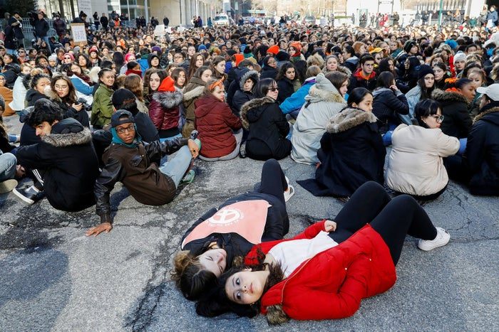 Students from Fiorello H. LaGuardia High School sit and lie down on West 62nd Street in Manhattan.