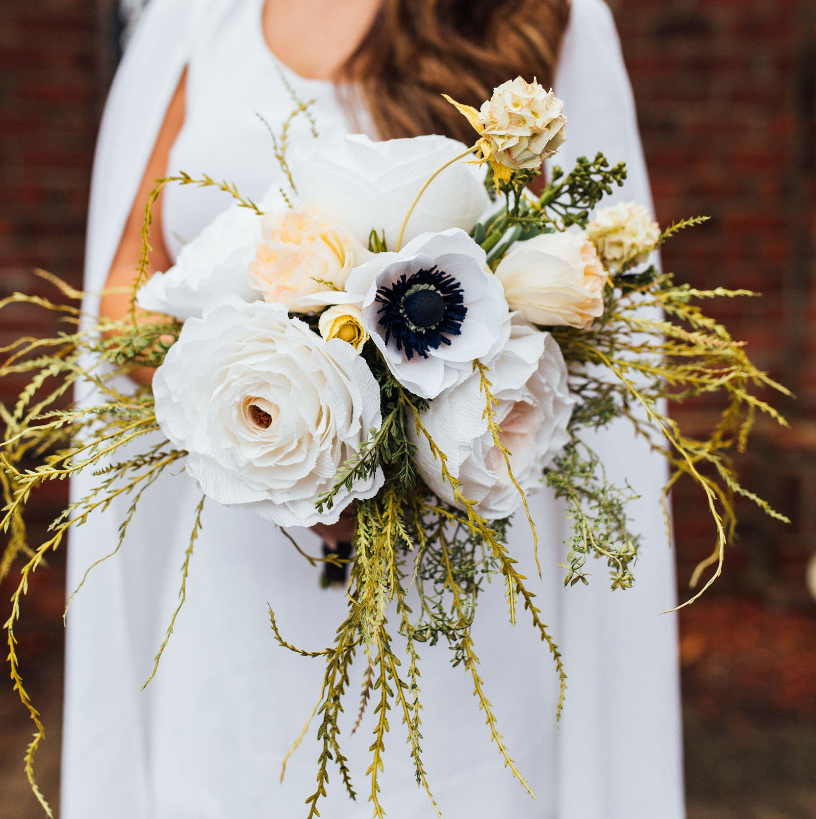 Crepe-paper flowers make a good alternative to a bouquet — and they'll last forever!