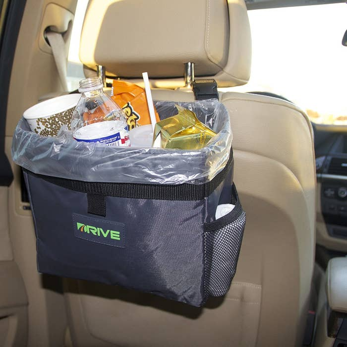 """Promising review: """"Where has this thing been all my driving life? My last car wouldn't have looked as messy as it did if I would have purchased this sooner. This is large enough to hold at least a half-eaten breakfast from Starbucks including a venti cup. It isn't too big that the person in the backseat feels like they have has a garbage bin under their nose. The fact that it came with spare garbage bags was a bonus! VERY easy to install and move from seat to seat if necessary! It still leaves your car looking as stylish as it did before you bought it!"""" —Amazon CustomerGet it from Amazon for $13.99."""