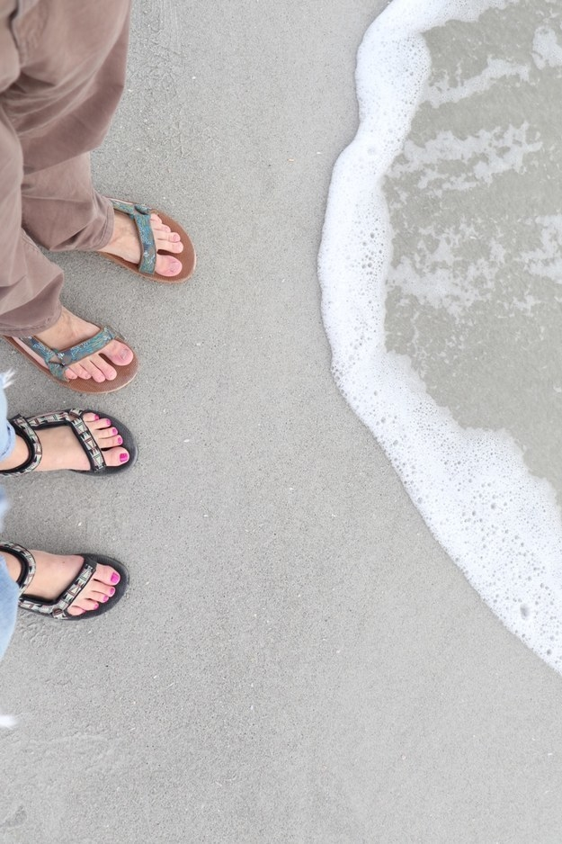 two readers wearing the black foam footbed ankle-strap sandals with strap connecting top toestrap to ankestrap