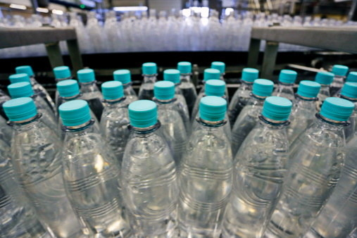 """Bottled water can contain thousands of tiny plastic particles, or """"microplastics,"""" according to a recent study."""