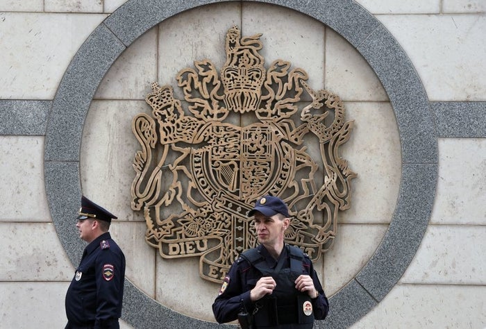A police officer patrols outside the British embassy building in Moscow