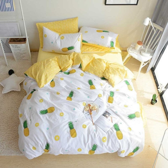 """The other side of the duvet is a sunny yellow so it'll feel like you just crawled into a cozy bed of sunshine.Promising review: """"I absolutely adore this duvet cover. According to my social media, other people love it too! It gets softer as you wash it, and it's such a lovely color on the flip side. I don't know, it just makes me happy to get into bed! The pillowcases tie it all together and I'd even buy more of them if they were sold separately! The ties on the inside make it easy to put on without any help needed and the zipper is very discreet. Definitely worth every penny."""" —HensaGet it from Amazon for $48.99+ (available in two sizes and seven cute prints)."""