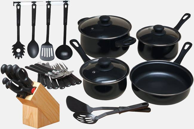 """The 32-piece set includes includes two saucepans with lids, one Dutch oven with a lid, one fry pan with a lid, one pan, one chef's knife, one bread knife, one boning knife, one utility knife, one paring knife, one pair of kitchen scissors, one wood block, one plastic serving spoon, one slotted serving spoon, one spatula, one slotted spatula, one pasta server, four dinner knives, four dinner forks, and four teaspoons. Promising review: """"For the price, everything is very good quality. The cookware and tools are not flimsy and aren't undersized. Everything was just right. It's a beautiful set, especially for a quick move like I was forced into. It was a really big relief to have this set to use. It is a great value!"""" —AlannaPrice: $33.68"""