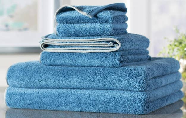 """The six-piece set includes two bath towels, two hand towels, and two washcloths. The towels are machine-washable. Promising review: """"I am ordering another set of these because the weight of the towel and the color is perfect. They dry just fine and are the type of towel to wrap around your head without straining your neck! They are very nice-looking towels."""" —Susan Price: $29.99+ (available in 14 colors)"""