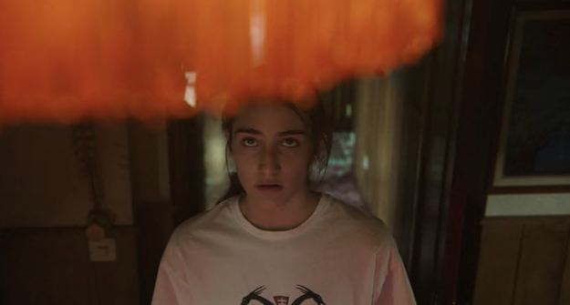 A number of minor creepy things happen: Veronica's backpack falls from a shelf, Veronica goes into a trance during dinner, a light flickers, a door closes on its own. Run-of-the-mill horror stuff.