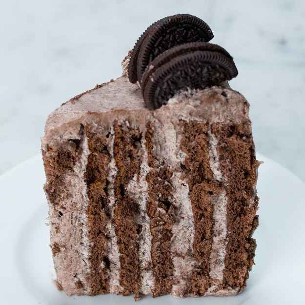 6 servingsINGREDIENTSCake10  large egg, seperated250 g (1 1/4 cups) sugar, divided1 teaspoon vanilla extract90 g (3/4 cup) cake flour60 g (1/2 cup) cocoa powder, divided1/2 teaspoon baking powder1/2 teaspoon saltIcing680 g (24 oz) cream cheese, room temperature115 g (1/2 cup) unsalted butter, 1 stick, room temperature640 g (4 cups) powdered sugar2 teaspoons vanilla extract15  chocolate sandwich cookie, crushed5  chocolate sandwich cookie, halvedPREPARATION1. Preheat the oven to 400°F (200°C). Line two baking sheets with parchment paper.2. In a large mixing bowl, beat the egg yolks with 1 cup (200 g) of sugar and the vanilla extract until pale and fluffy, about 3 minutes.3. Sift in the flour, half of the cocoa powder, baking powder and salt. Mix until just combined, and set aside4. In a separate large mixing bowl, using a hand mixer, beat the egg whites until soft peaks form. Add the remaining sugar and beat until stiff peaks form.5. Beat a third of the egg whites into the chocolate mixture, then gently fold in the remaining egg whites.6. Divide the batter between the two baking sheets. Spread evenly and bake for 10-12 minutes.  Let cool at room temperature until the pans are cool to touch.7. Dust the tops of the cakes with the remaining cocoa powder. Cover with parchment paper, and flip the cakes over to remove from the pans.8. Carefully peel away the baked parchment paper and discard. Cut each cake in half vertically, then set aside.9. In a large bowl, whip the cream cheese and butter until fluffy. Gradually incorporate the powdered sugar, then the vanilla extract.10. Use a spatula to fold in the crushed cookies.11. Evenly spread a thin layer of icing onto a cake quarter.12. Starting from one short end, tightly roll the cake into a spiral. Repeat with the remaining cake layers, placing the rolled piece at the start of each new layer.13. Wrap the cake tightly in plastic wrap and chill for at least an hour until icing in center is slightly firm.14. Use the remaining 