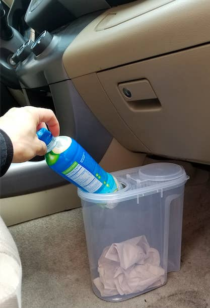 Check out this hack and other DIY car organization ideas from VasseurBeauty.Get this exact container from The Container Store for $7.49.
