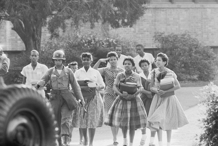 """Minnijean Brown, Elizabeth Eckford, Ernest Green, Thelma Mothershed, Melba Patillo, Gloria Ray, Terrence Roberts, Jefferson Thomas, and Carlotta Walls were ready to start high school at Little Rock Central High School in September 1957, three years after Brown v. Board of Education. The group of teenagers put their lives on the line for equal education, receiving counseling on what to do if the situation turned hostile, which it eventually did. Rifle-toting Arkansas National Guardsmen blocked the students from entering, and a three-week standoff ensued, which was only ended when President Eisenhower sent federal troops to escort them in. Still, the teens faced abuse: Eckford was spat on, Patillo had acid thrown in her eyes, and all were taunted. Brown was even expelled for trying to fight back against the torment she faced. Even amidst a school shutdown and continued intimidation, all eventually graduated from high school against the odds. The entire group received the Congressional Gold Medal in 1998 to honor their """"selfless heroism."""""""