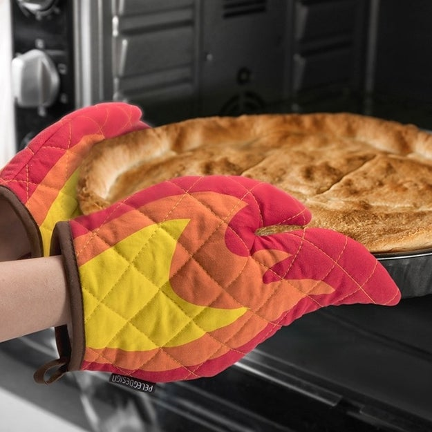 A pair of flame oven mitts that can handle the hottest of dishes. They look like FIRE, literally.