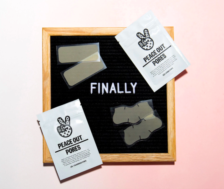 rectangle and nose shaped patches shown next to the bags that have peace hand signs on them