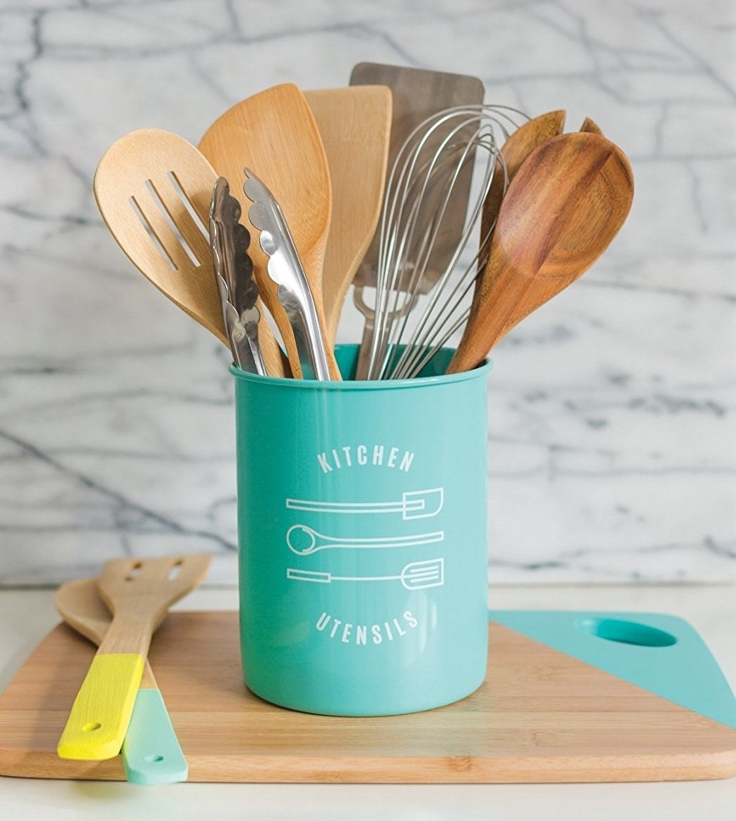 "Promising review: ""As silly as it sounds, I had been looking for a nice utensil holder for quite a while. This appears exactly as shown in the pictures and is made of a durable, easy to clean plastic material. It holds about a dozen assorted full-sized utensils (whisks, spatulas, marinade brushes, etc.), and looks great on my counter! The simple design pairs well with any kitchen and offers a great alternative to a boring plain or bamboo container."" –EmilyGet it from Amazon for $11.98+ (available in five colors)."