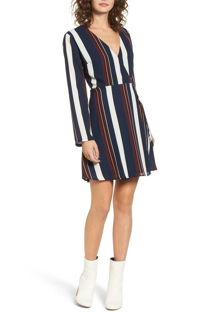 """Promising review: """"This is the most versatile dress! I can wear it to work, out, or just casually with a pair of cute sneakers. It fits true to size and the wrap is fitted great around the midsection. I ended up getting it in a print as well as a solid color."""" —SamK12345Price: $29.40+ (available in sizes XS-XL and in eight prints)."""