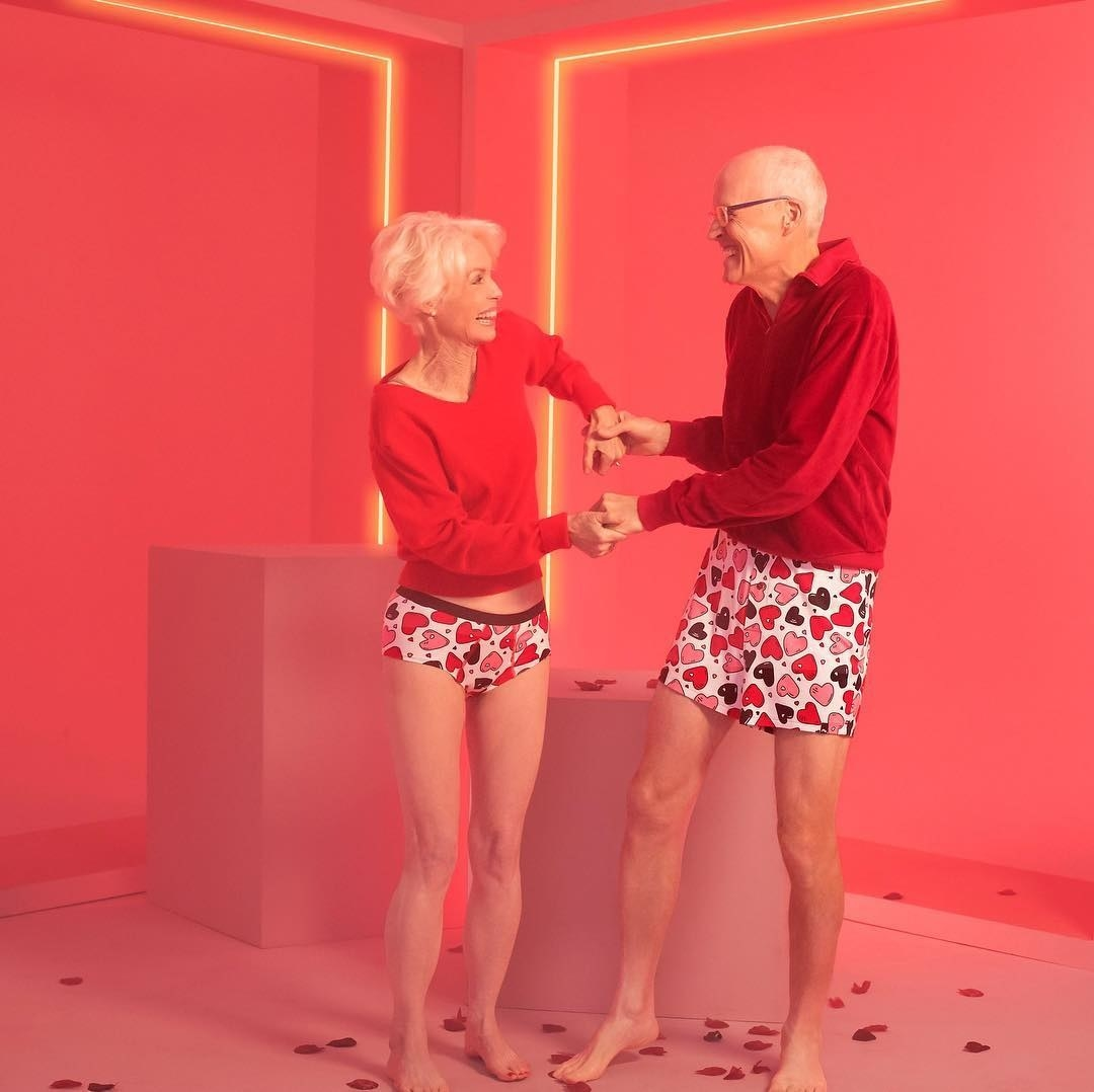 Two models in undies in the same heart print: one in bikini-style, and one in boxers