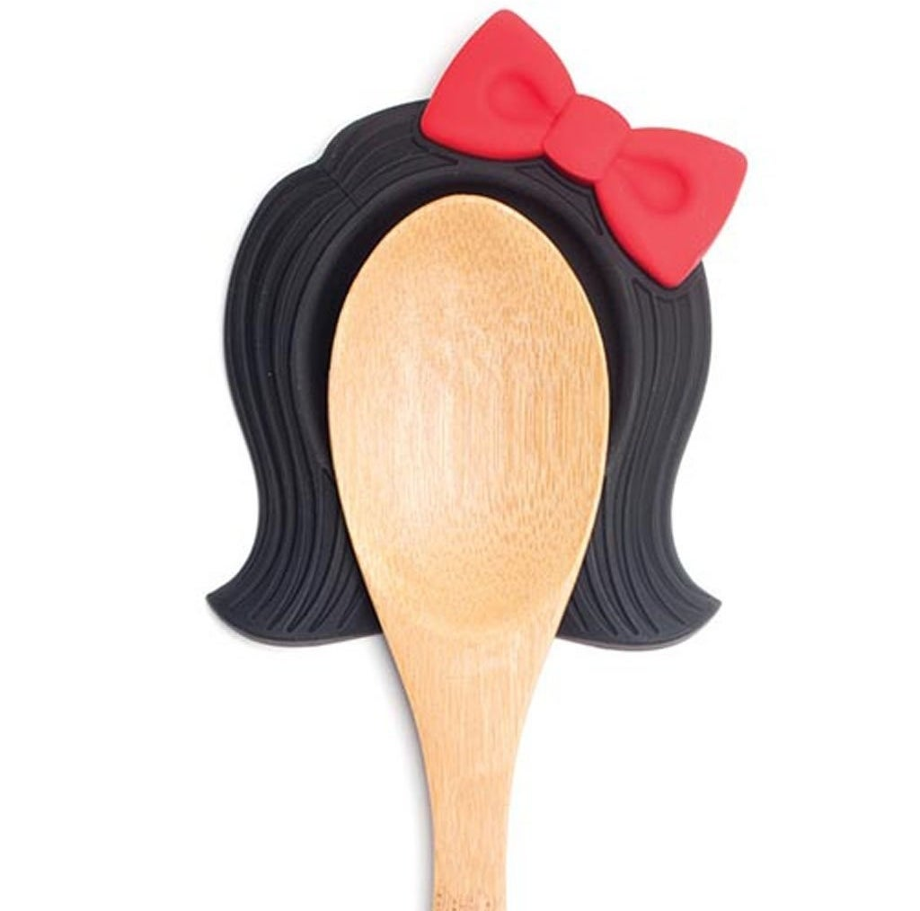 A silicone spoon rest with the magic ability to make a utensil look like Linda Belcher from Bob's Burgers (if Linda wore a bow, that is).