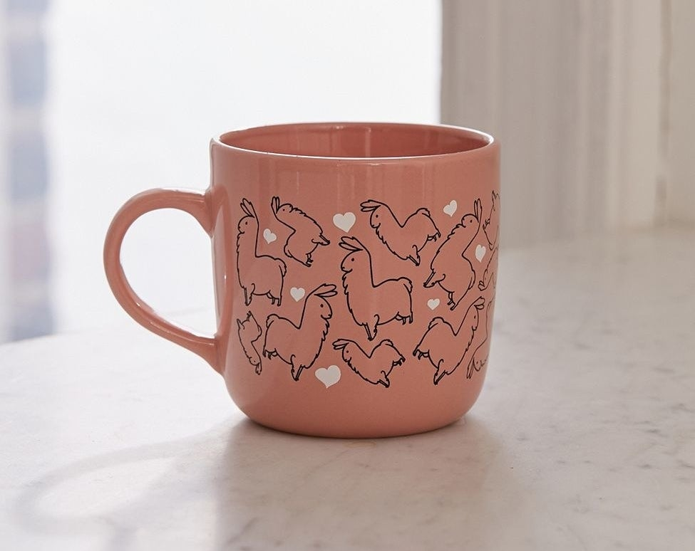 A ceramic coffee mug because coffee is even more enjoyable when it's served with a side of llamas.