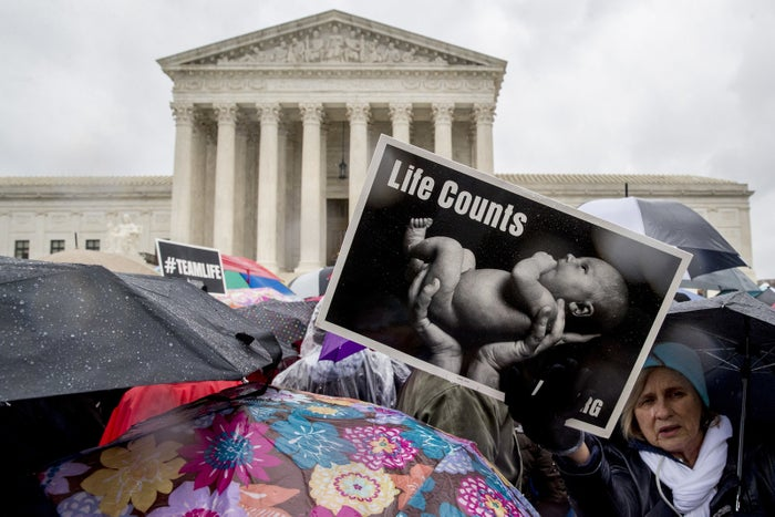 Anti-abortion supporters attend a rally as the Supreme Court hears arguments in a free speech fight over California's attempt to regulate anti-abortion crisis pregnancy centers.