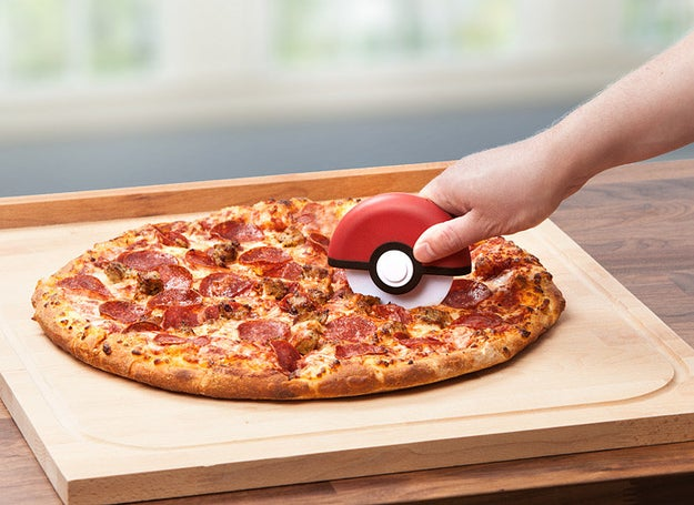 A Poké Ball pizza cutter you might as well just buy because it's a combination of your two fave things.