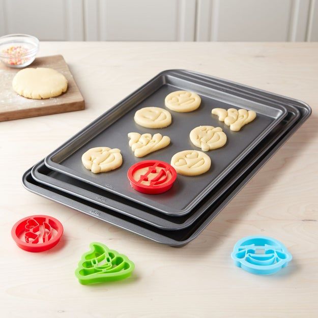 A non-stick cookie sheet set with emoji cookie cutters for baking treats as tasty as they are Instagrammable.