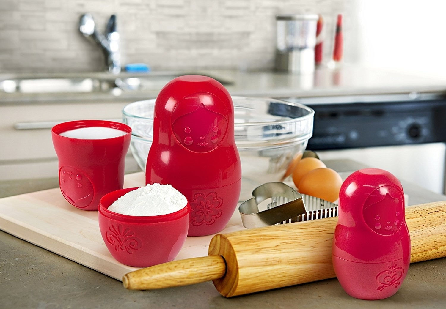 A matryoshka doll measuring cup set that'll nest neatly for storage.