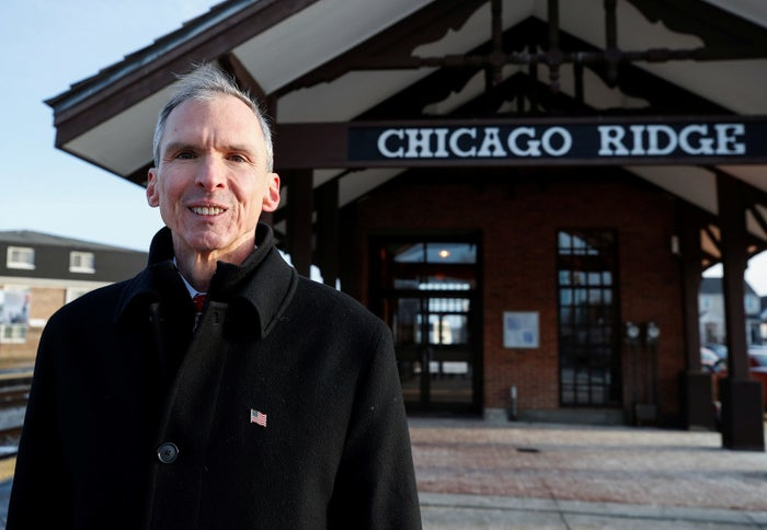 Rep. Dan Lipinski campaigns for reelection at the Chicago Ridge Metra commuter train station.