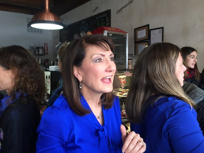 Democratic candidate Marie Newman speaks with supporters while campaigning to replace Rep. Dan Lipinski in Congress.
